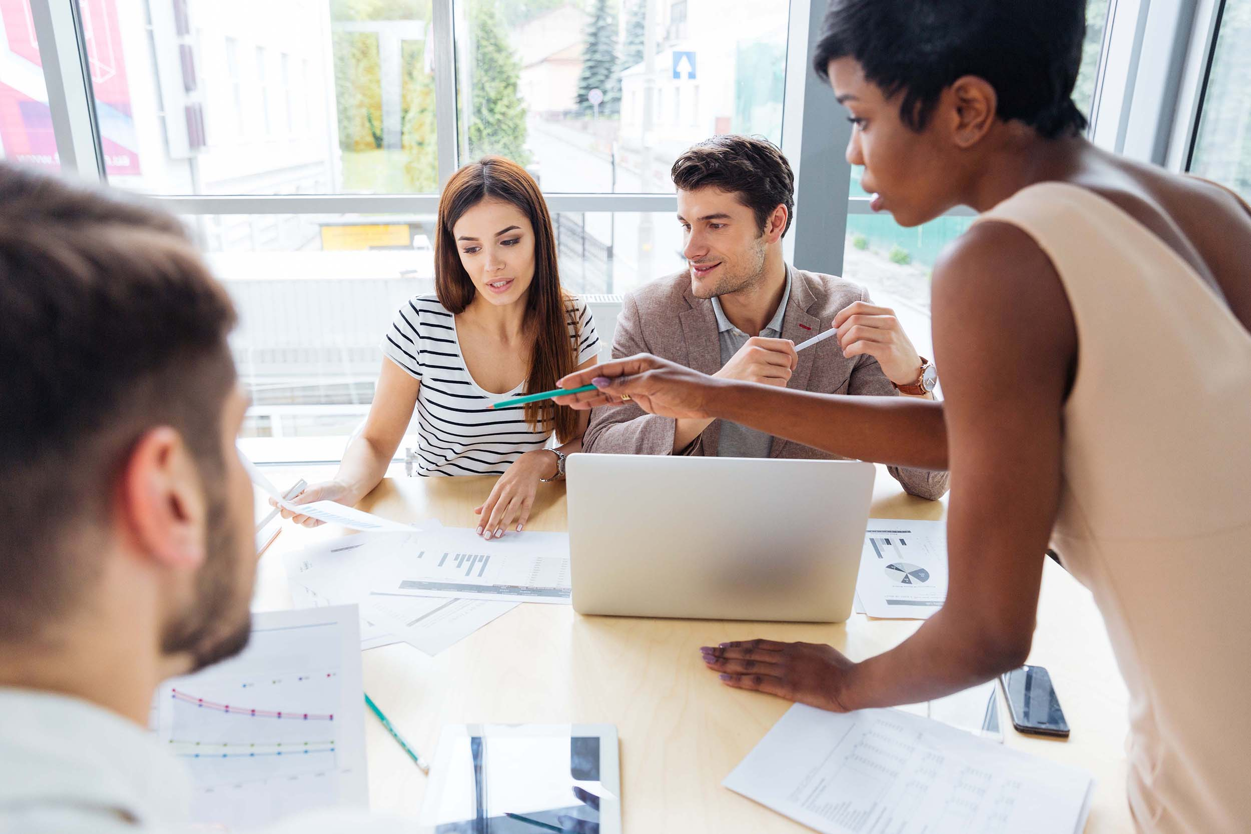 graphicstock-multiethnic-group-of-young-business-people-preparing-for-presentation-together-in-office_ruLcYmQS3x